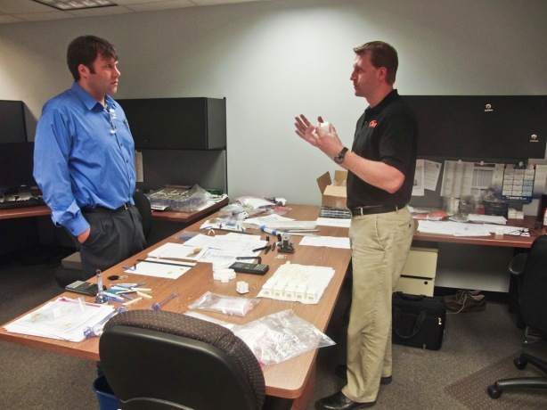 Matt Proske, Vice President, SIGMA Plastic Services (Left) and Stafford Frearson, Project Engineer at Tessy Plastics, have a conversation at Tessy Plastics in Elbridge, NY.