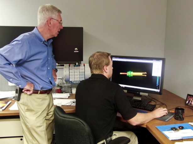 Eric Frearson, Vice President of Engineering, Tessy Plastic (Left) and Stafford Frearson, Project Engineer at Tessy Plastics, discuss a SIGMASOFT screen at Tessy Plastics in Elbridge, NY.