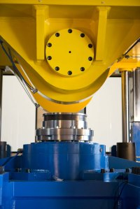 The unique operation of this MJC rotary forging press involves the application of pressure on a small portion of material at a time, reducing stress and saving up to 90% in material, compared to subtractive machining from a solid blank