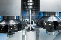 Machining area of the VL 2: 12 turning or, alternatively, up to 12 driven drilling and milling tools can be employed to carry out a large number of operations in a single setup. The machine can also be equipped with an optional Y-axis.