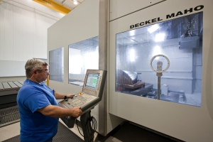 Milling, line boring and turning operations are performed on large multi-axis machine tools, most equipped with Siemens SINUMERIK 840D CNC onboard to control all axes of motion.
