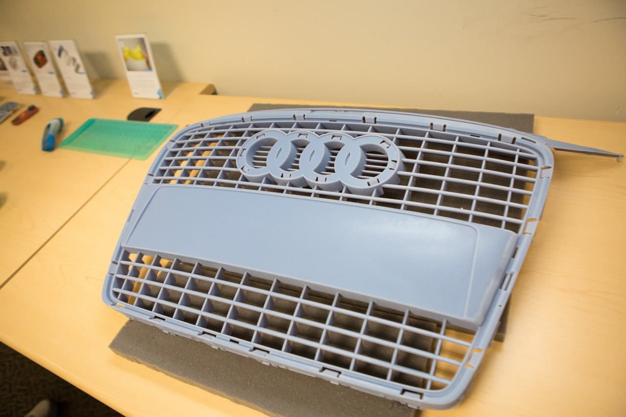 An example of a 3D printed car grill at 3D Vision's offices